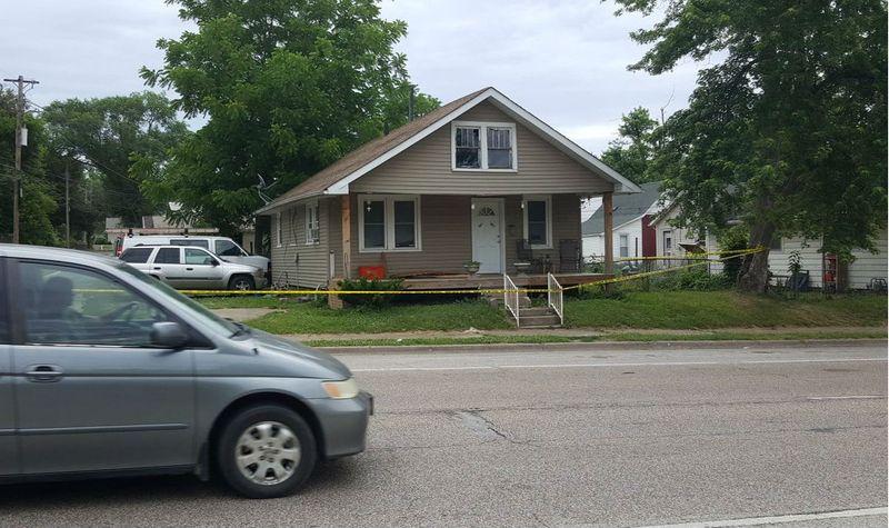 Crime scene tape surrounds house