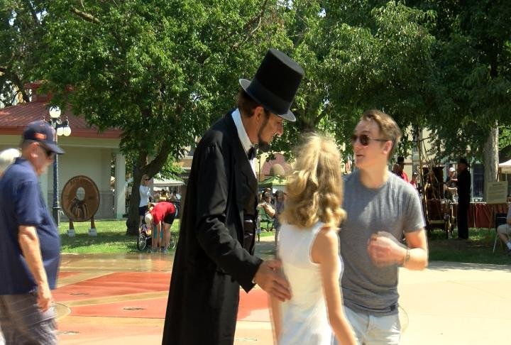 Abraham Lincoln interacting with festival goers