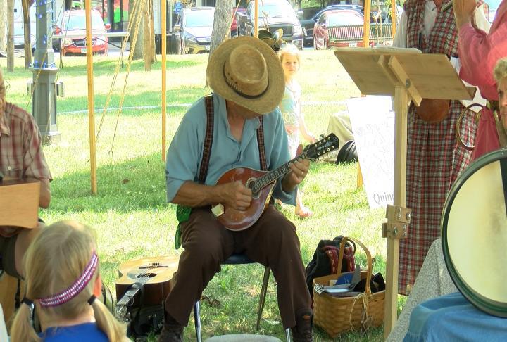 Festival goers enjoying music from the 1800s