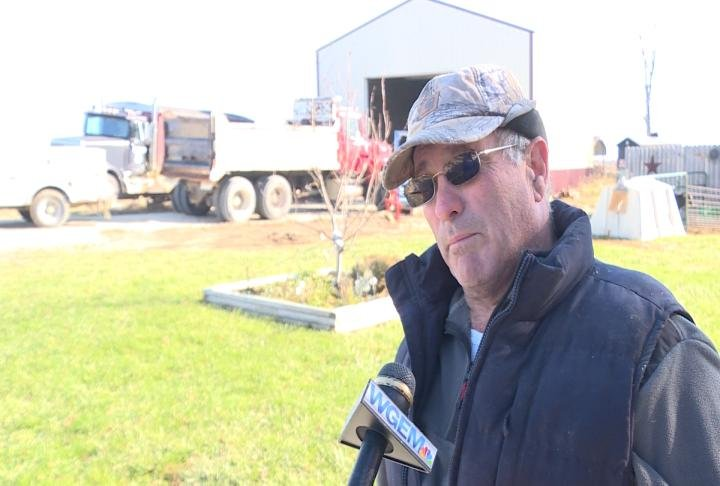 Griesbaum talking to reporters about farm related story.
