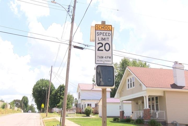 The school speed zone signs at the former Dewey Elementary School will soon be coming down.
