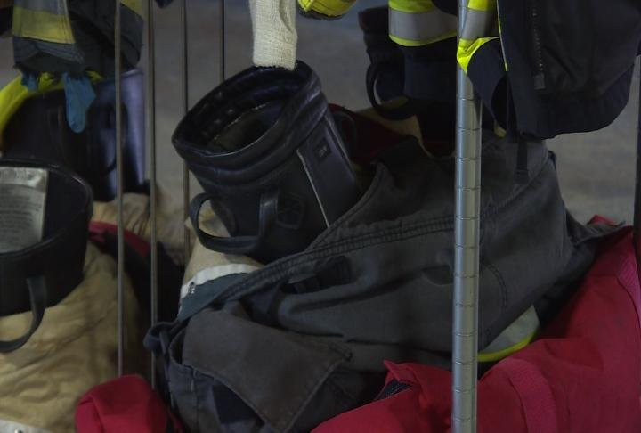 Firefighting gear includes a coat, pants and suspenders.