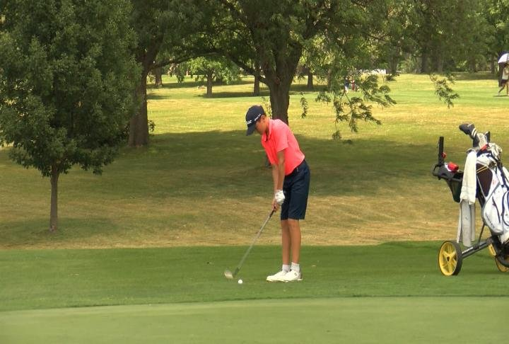 Hannibal's Quinn Thomas chips his way to 3rd place in the boys 12-13 group on Wednesday.