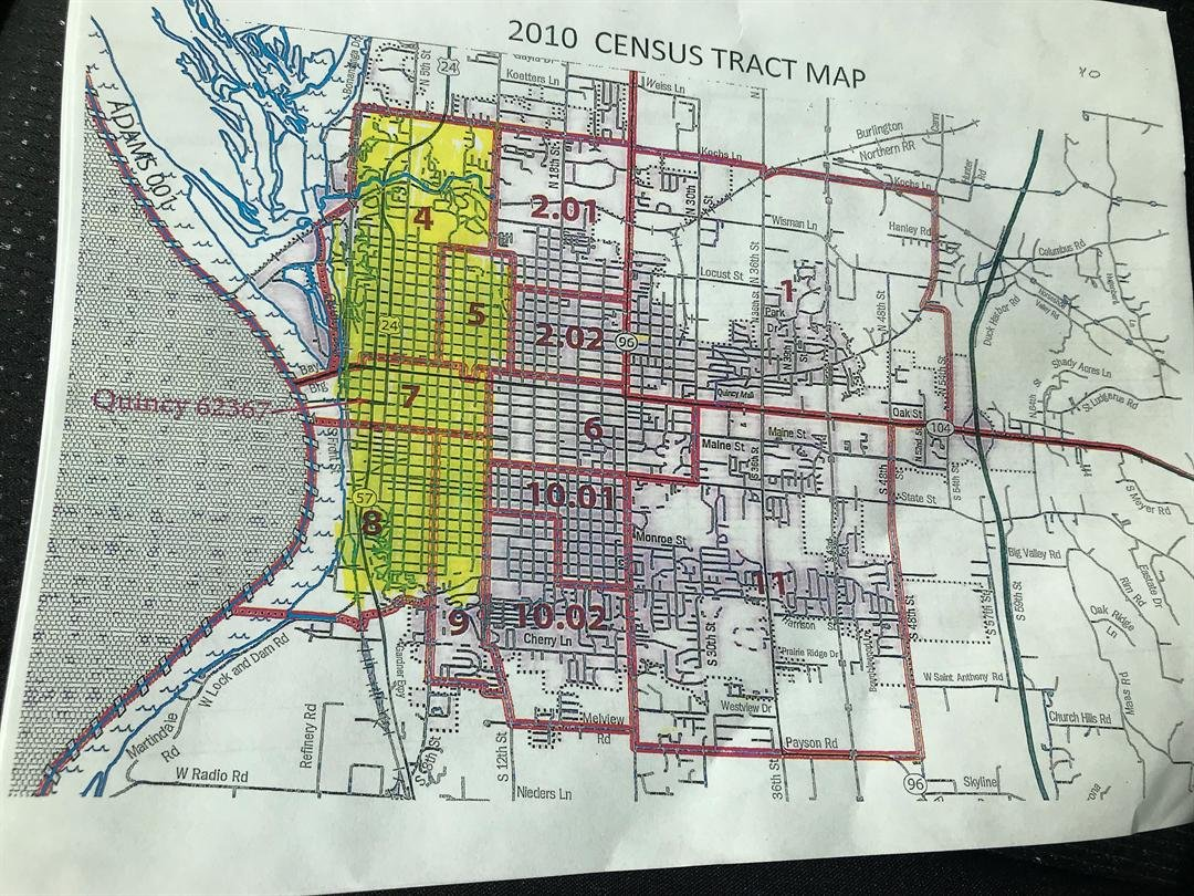 Distressed census tracts are highlighted in yellow.