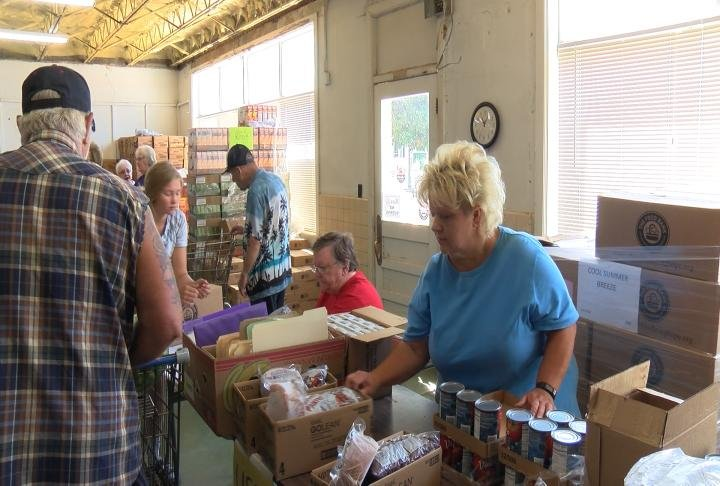 A volunteer checking out a patron of the food pantry.