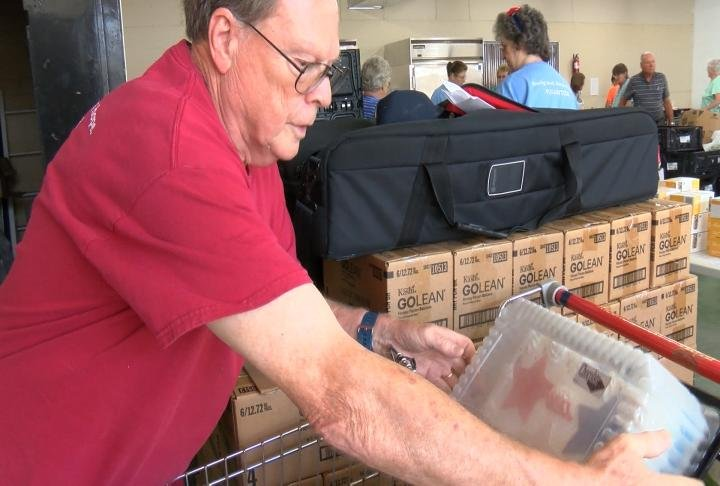 Jerry Prather unloading food from a freezer.
