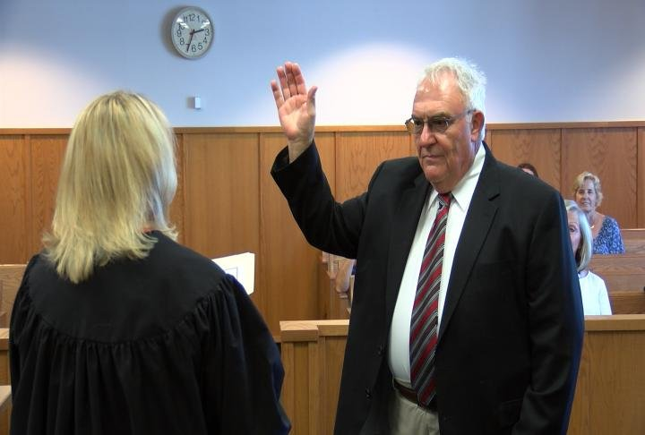 New coroner John Myers being sworn-in.