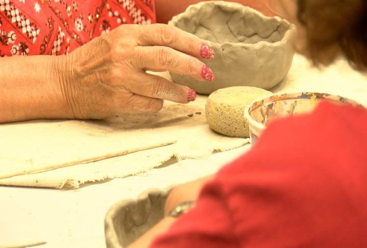 Veterans working with clay