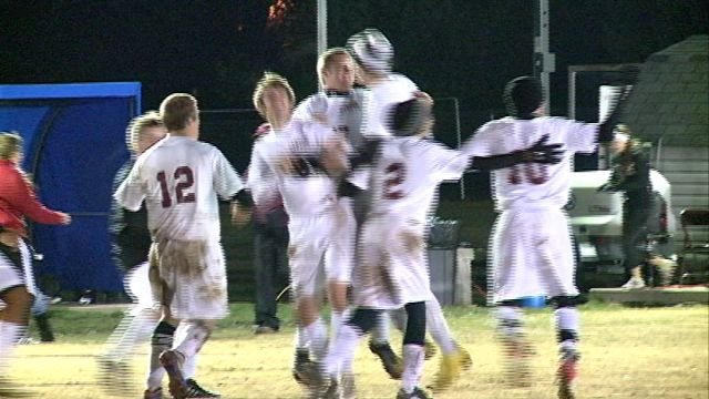 The Canton Tigers celebrate after Tyler Niemann scores the game winning goal in OT on Wednesday.