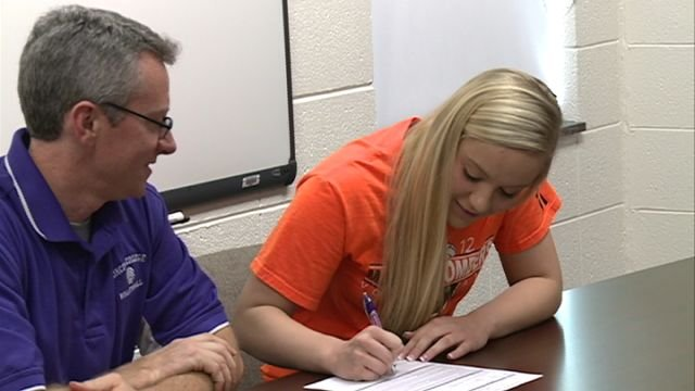 Macomb's Jessa Coker made her future intentions known Tuesday signing with Lincoln College spikes.