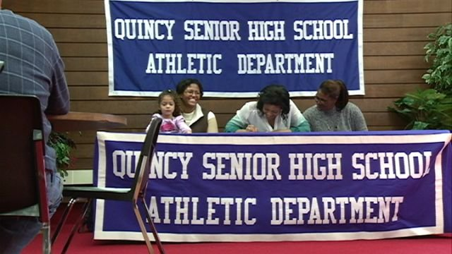 India Green signs her letter of intent on Tuesday afternoon at QHS.