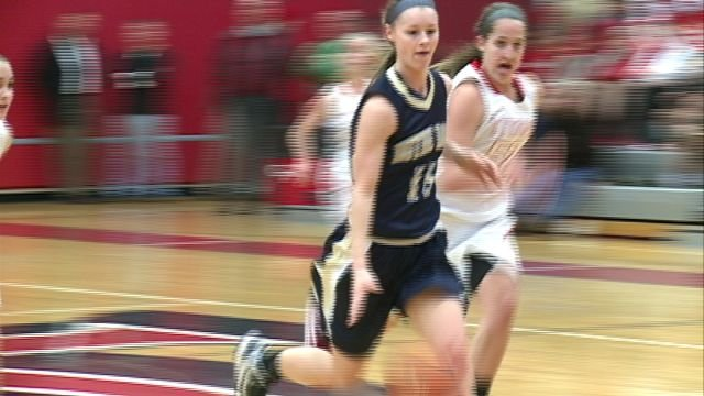 QND's Kassidy Gengenbacher scored a team high 22 points as the Lady Raiders held off Chatham-Glenwood 49-38 to stay undefeated.