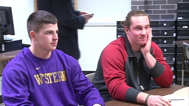 Macomb's Brett Taylor (left, Western Illinois) and Nick Severs (right, Iowa State) both signed their national letters of intent on Wednesday afternoon.