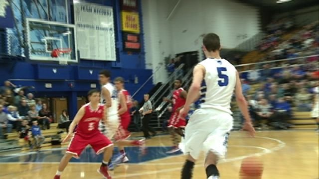 Quincy High's Martin Kvitle scored 16 points to lead the Blue Devils past Jacksonville on Senior Night.