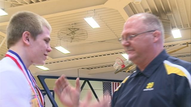 QND wrestling coach Ken Mansell and senior Gage Stephens share a handshake following Tuesday's pep rally to honor the Raiders.