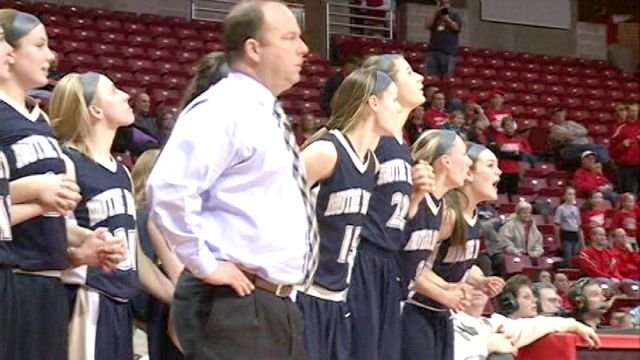 The QND Lady Raiders get ready to celebrate after beating Morton 67-51 in Friday's state semifinal at Redbird Arena.
