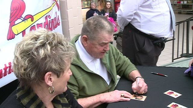 Cardinals Hall of Fame manager Whitey Herzog signs autographs at the Quincy Mall on Saturday.