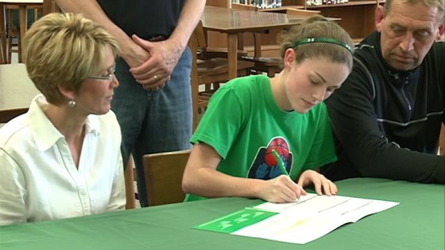 Pittsfield's Shea O'Brien signs her letter of intent with John Wood basketball on Tuesday afternoon.