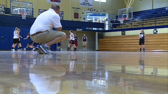 Illinois all-star coach Eric Orne looks on at Tuesday's practice as his team prepares to the McDonalds/Herald-Whig Classic.
