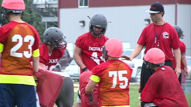 First year head coach Scott Murdock works with the Indians at Monday's practice in Kahoka.