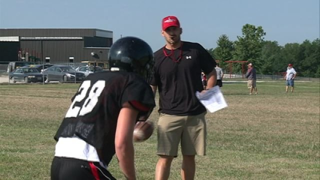 Head coach Alex Van Delft works with his squad during Saturday afternoon's practice at Knox County High School.