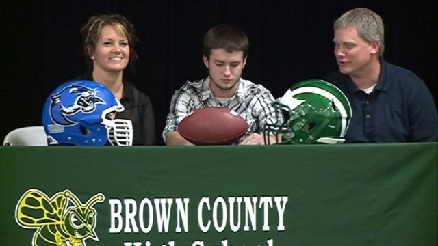 Brady Long sings his national letter of intent to play football at Culver-Stockton on Monday at Brown County high school.