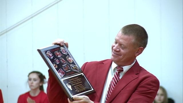 Mike Johnson received a plaque on Tuesday night following the final home game in his last season as the head coach of Marion County girls basketball.