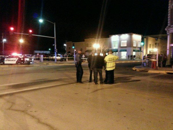 Officers gather during investigation into officer-involved shooting reported in downtown Hannibal.