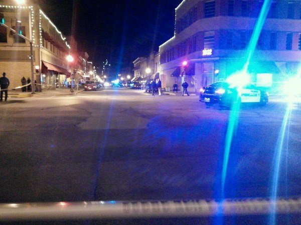 Police canvas downtown Hannibal Saturday night after officer-involved shooting.