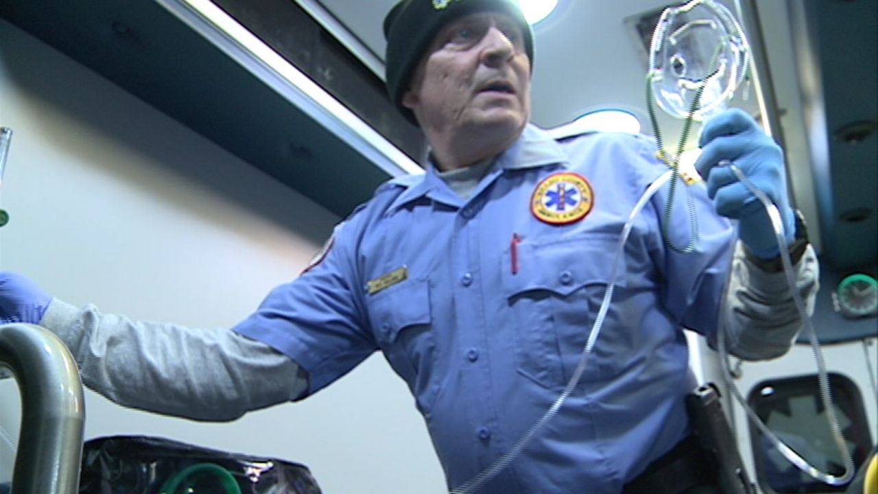 Paramedic Bill Ballard prepares to give a patient oxygen inside an Adams County EMS ambulance. He's frustrated being dispatched to some medical calls he says aren't true emergencies.
