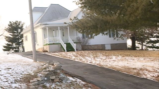 Police searched this home and another, and say they found enough heroin to fill 800 capsules.