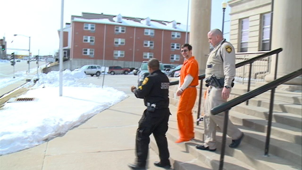 JD Foust is escorted out of court Friday.