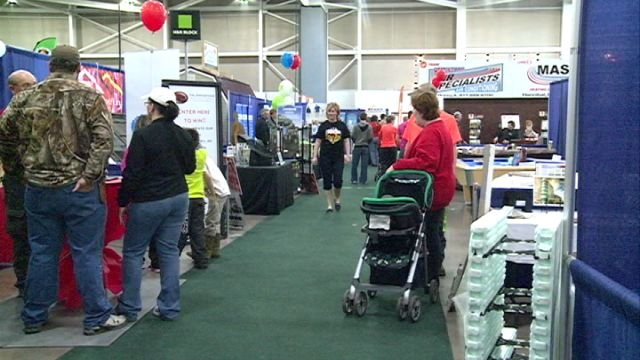 Vendors speak to people at the WGEM Home and Living Show.