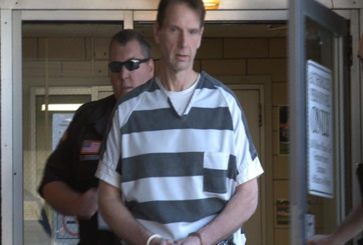 Curtis Lovelace is led out of the Adams County Courthouse Thursday afternoon.