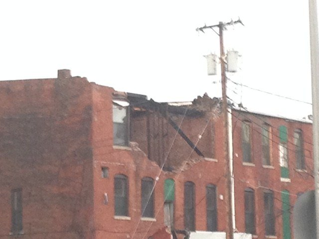 Nearly 70 mph winds knock down bricks in building on Jail Alley in Quincy.