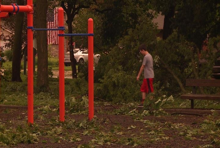 Residents walking through Madison Park after storms damaged the area.