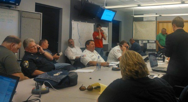 Adams County and Quincy officials gather late Monday night after a storm ripped through the area.