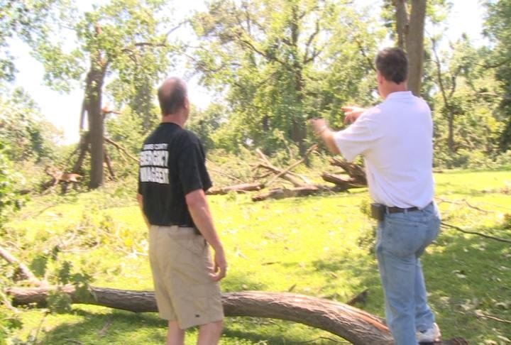 National Weather Service meterologist inspect damage from Monday night's straight line storm.