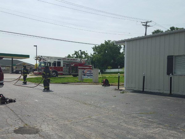 Firefighters respond to call at painting business Wednesday morning.