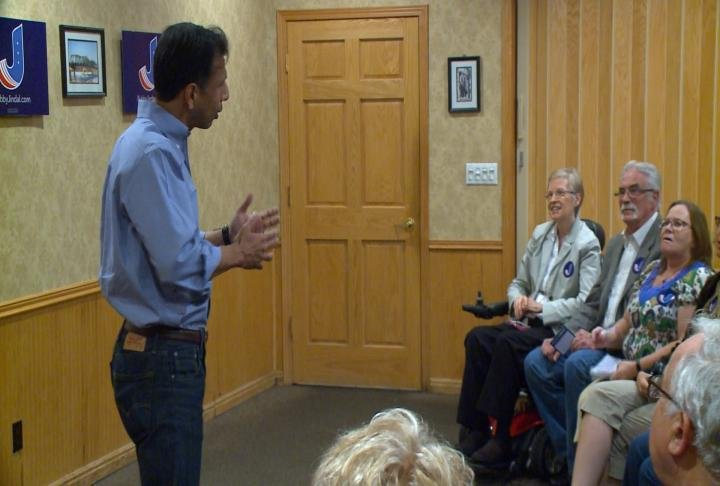 Bobby Jindal talks with supporters.