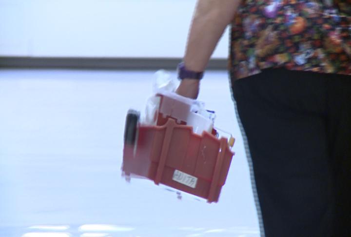 A nurse carries a kit down the hall at Keokuk Area Hospital.