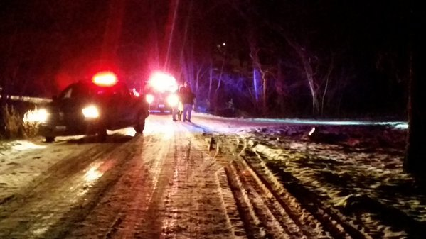 Squad cars park on a Marion County road Tuesday night after a man was shot.