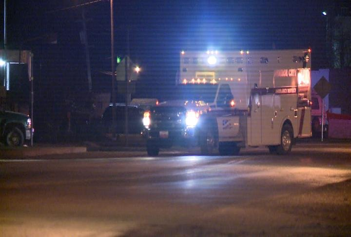 An ambulance parks in Monroe City Wednesday night after an officer-involved shooting.