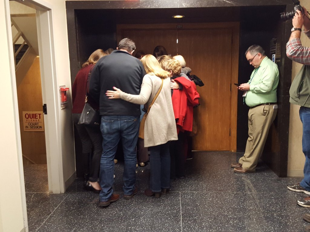 Members of the Lovelace family gather Thursday outside the courtroom.
