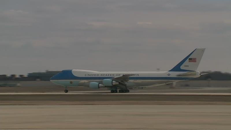 Air Force One speeds down the runway just before takeoff Wednesday morning.
