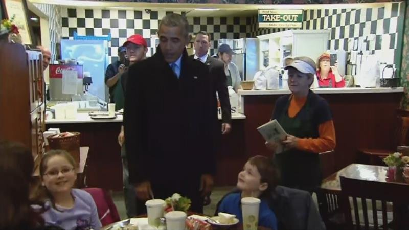President Obama meets with people at the Feed Store Wednesday.