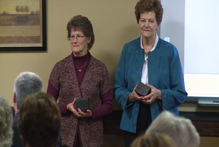 Two volunteers are honored at the Hannibal Free Clinic luncheon on Thursday.