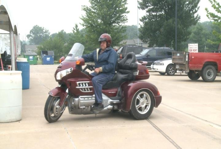 84-year-old Ed Staggs rides his motorcycle home on Tuesday.