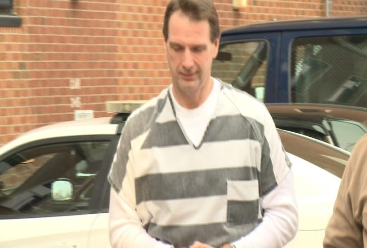 Curtis Lovelace being brought in to the Adams Courthouse on Friday.
