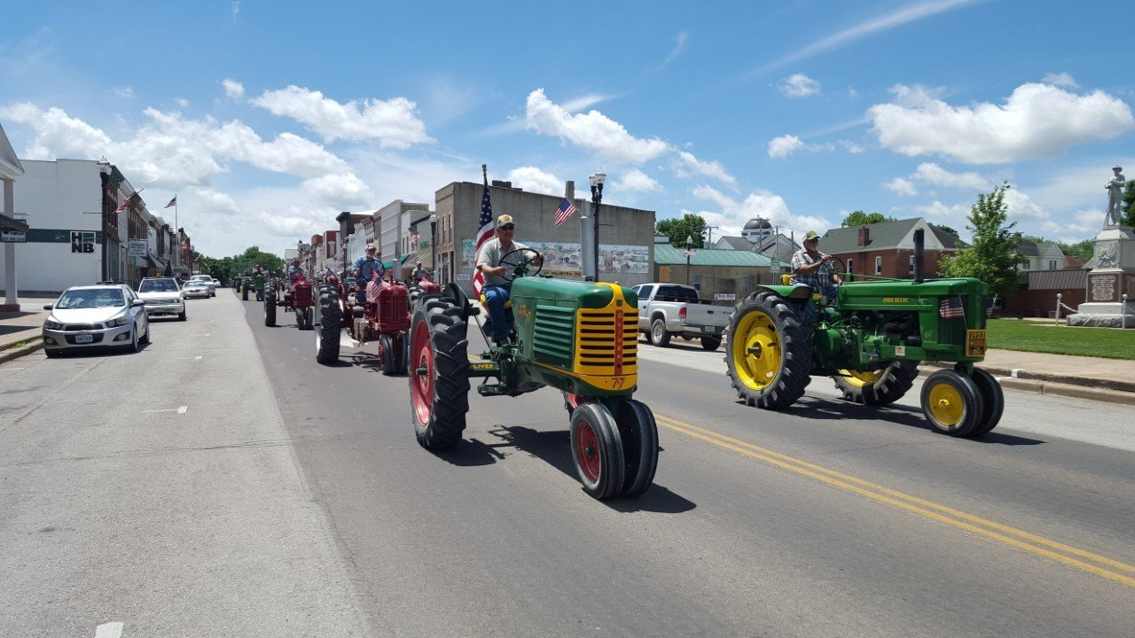 Tractor Drive fundraiser by the North River Iron Club for Great River Honor Flight  goes through Palmyra on their way to Hannibal.
